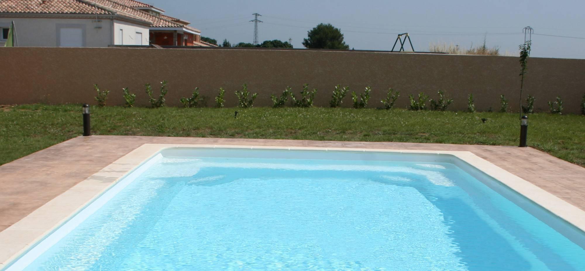 Ferre piscines piscine avec toboggan ile de france ferre for Piscine ile de france avec toboggan