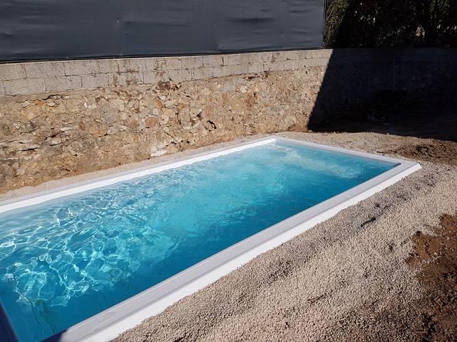 mini piscine avec filtration traditionnelle ferr piscines. Black Bedroom Furniture Sets. Home Design Ideas